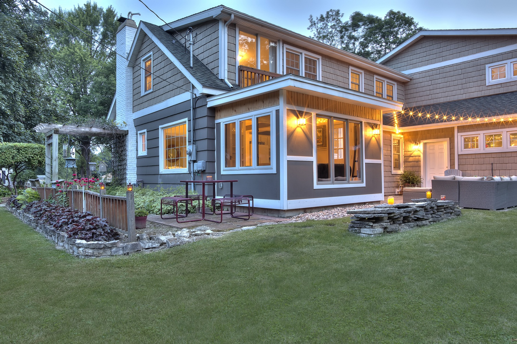 Beautiful restored Cape Cod style house exterior at dusk